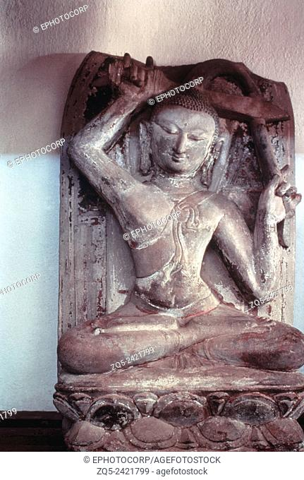 Gautama cutting his hair (the Tonsure). Height: 32, width: 8. Stone sculpture originally from the Shwe Chaung Kubyauk-ng Temple, now at the Pagan museum