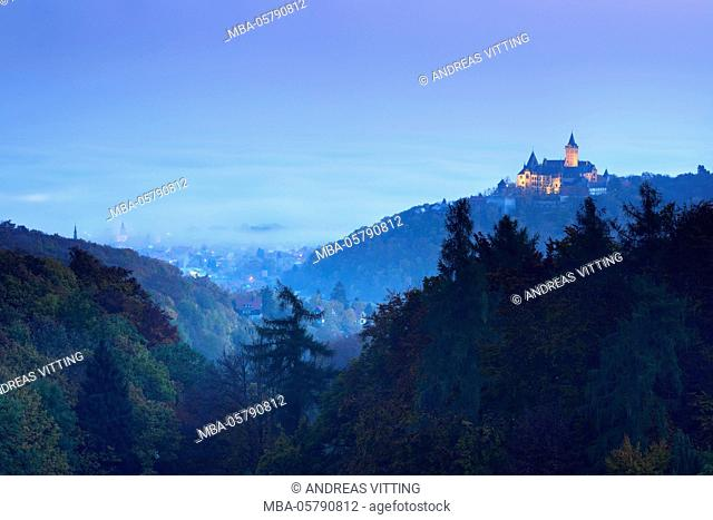 Town and castle Wernigerode at daybreak, in the background morning fog, Wernigerode, Saxony-Anhalt, Germany