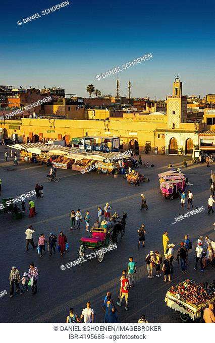 Many people on Djemaa el Fna square, UNESCO World Heritage Site, in the evening light, Marrakech, Morocco
