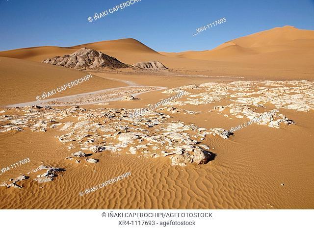 Salt concretions, dunes and Akakus massif near Ghat, Wadi Tanezzouft, Ghat, Libia