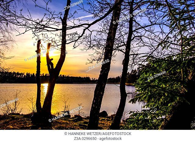 Sunset at al ake in Sweden