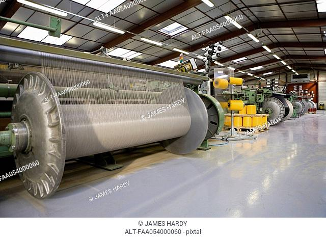 Fabric coating plant, weaving department, weaver's beam and loom