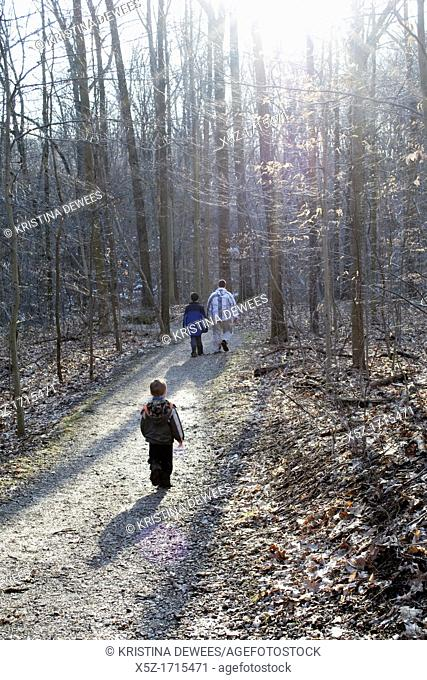A young boy follows his Father and older brother on an Ohio trail