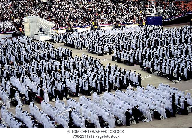 Members of the Unification church gather for a mass wedding at the RFK Stadium in Washington, DC