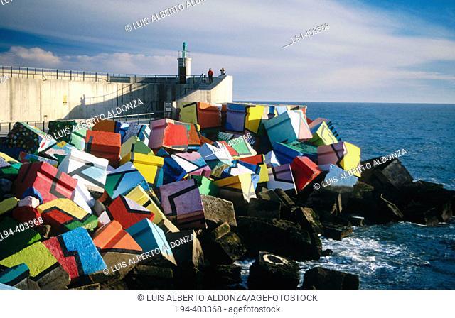 'Los Cubos de la Memoria' (the cubes of memory, work by sculptor Agustin Ibarrola in the seaport). Llanes village. Asturias. Spain