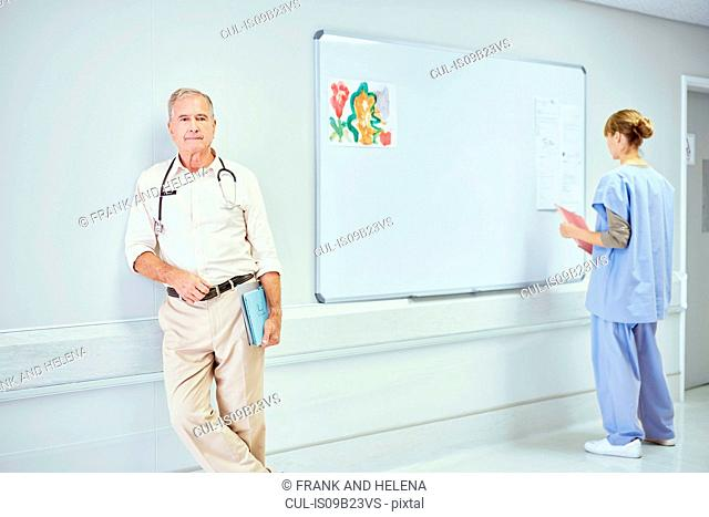 Portrait of senior doctor in hospital ward