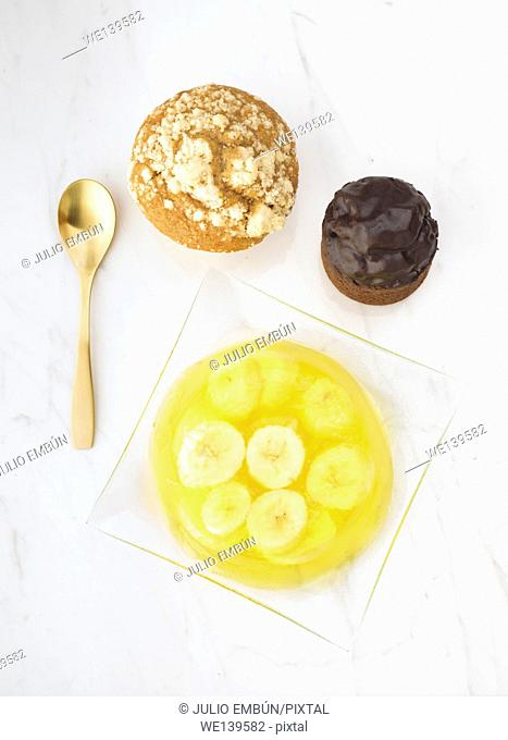 gelatin dessert with banana on white marble