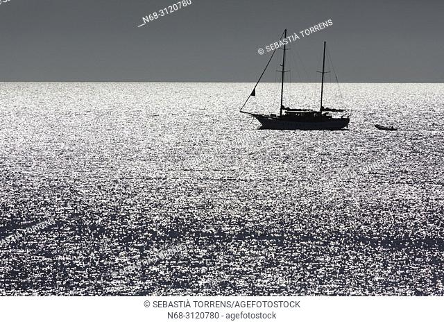 Backlighting view of a yacht from Formentera, Balearic Islands, Spain