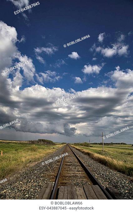 Storm Clouds Saskatchewan Prairie scene Train Tracks