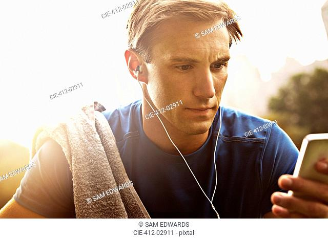 Runner listening to mp3 player