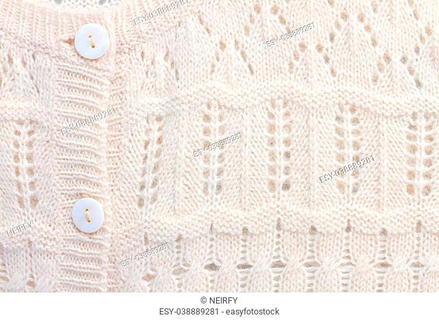 texture of white knitted soft sweater background buttons