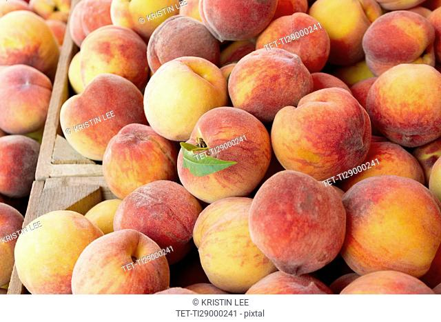 Peaches in wooden crate