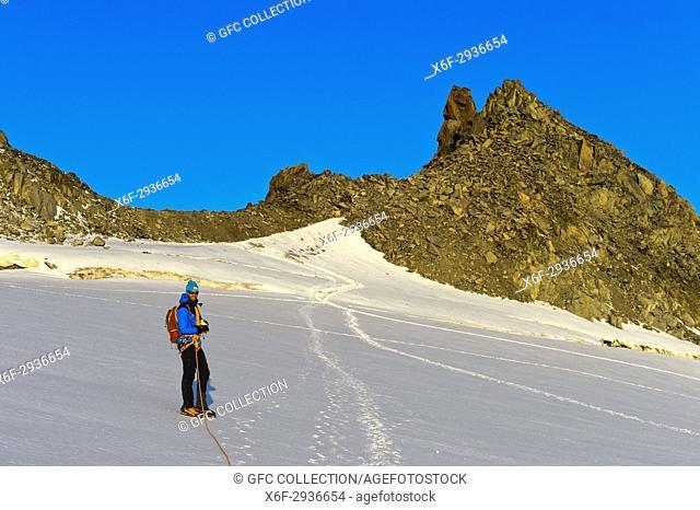 Alpinist at the mountain pass Col du Tour on the Plateau du Trient, Valais, Switzerland