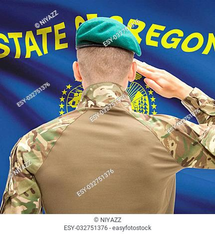 Soldier saluting to US state flag series - Oregon