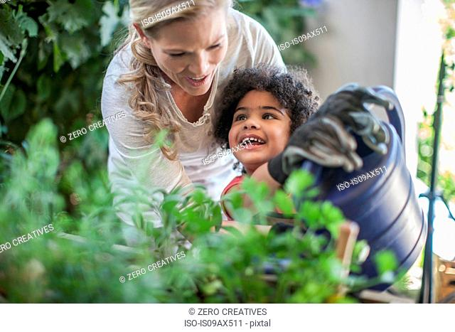 Mother and son doing gardening together