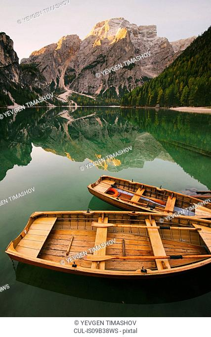 Boats moored at Lago di Braies, Dolomite Alps, Val di Braies, South Tyrol, Italy
