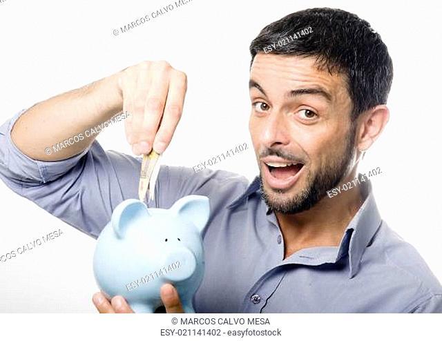 Young Man kissing Piggy bank
