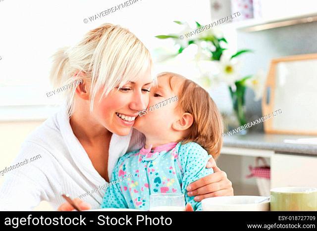 Simper mother and daughter having breakfast