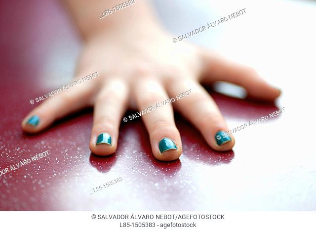 Hand girl with painted nails