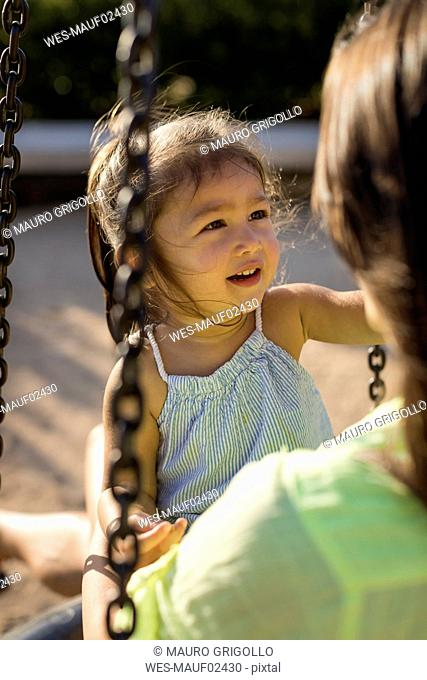 Portrait of a girl with her mother on a playground
