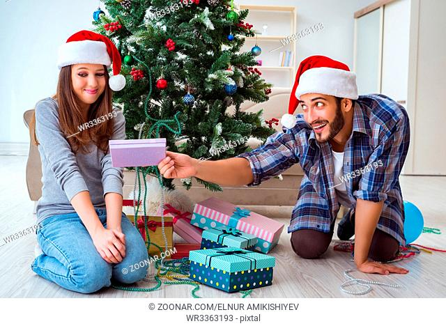 Girlfriend and boyfriend opening christmas gifts