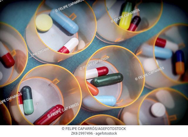 Daily medication at a hospital table, conceptual image