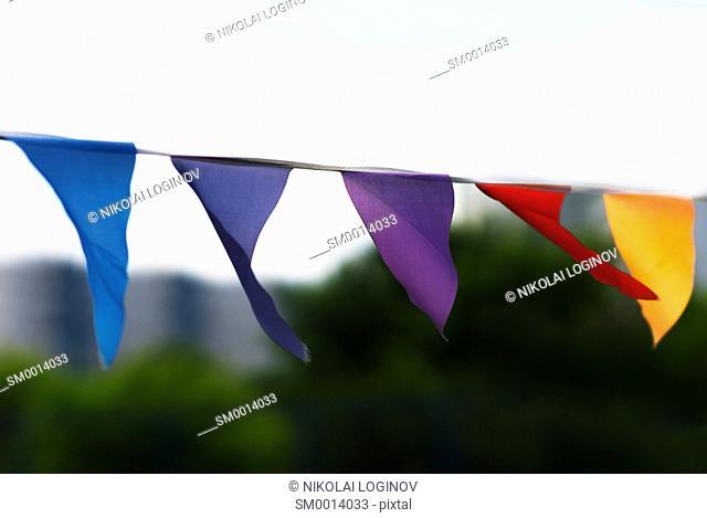 Horizontal vivid waving flags bokeh background backdrop