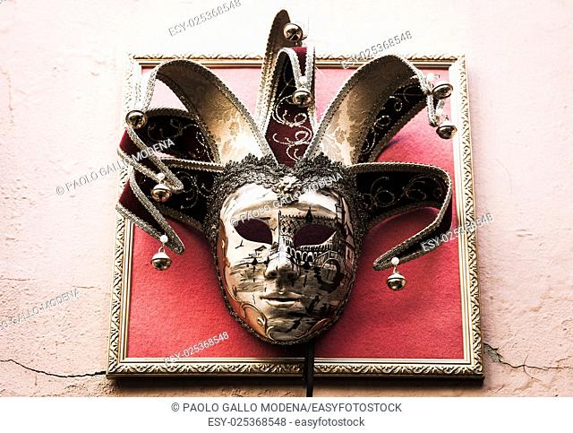 Traditional Venetian Mask on old wall background