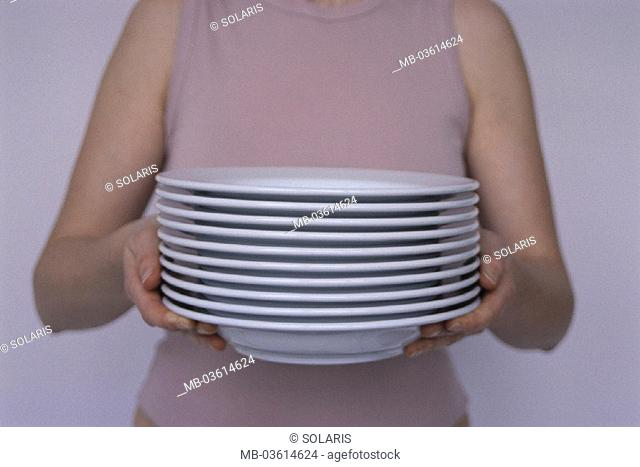 Woman, plate stack, carries