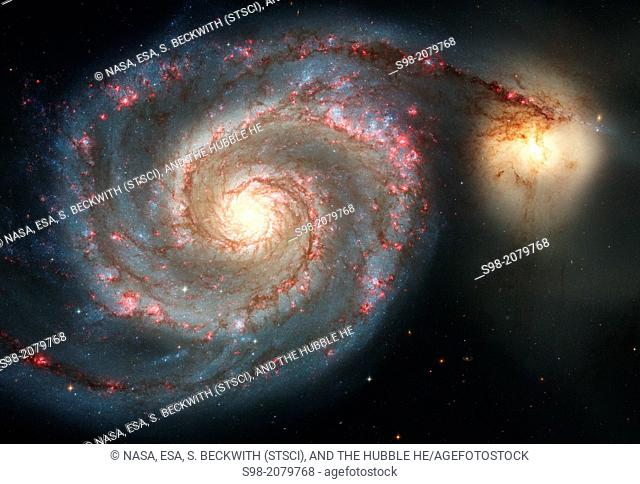 The graceful, winding arms of the majestic spiral galaxy M51 (NGC 5194) appear like a grand spiral staircase sweeping through space