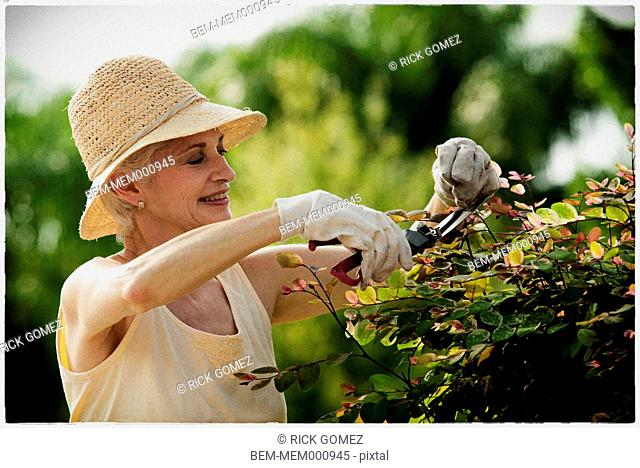 Older woman gardening outdoors