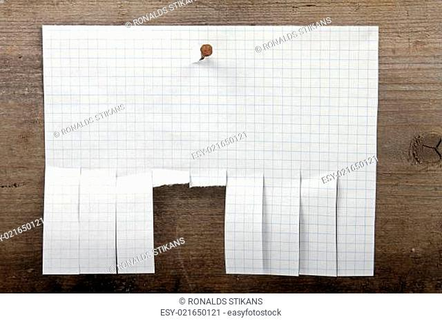 advertisement paper with cut slips hanging on nail