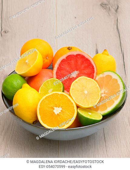 Colorful Assortment Of Citrus Fruit on Wooden Table