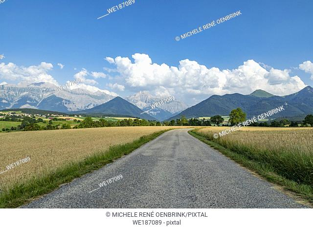 Panoriamic of The mountains of the Cuchon and Petite Autane with the village of Les Faix, Champsaur, French Alps in summer. Hautes-Alpes