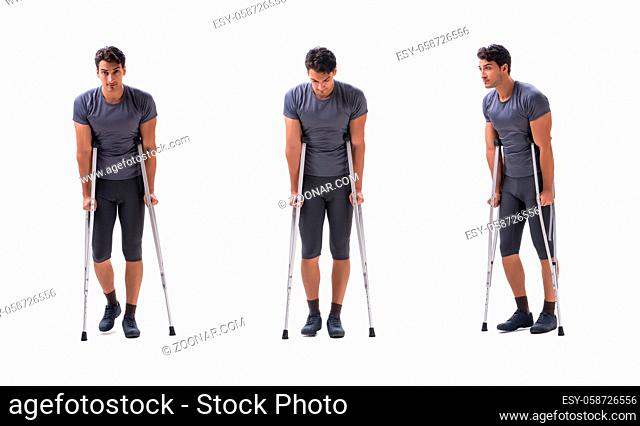 Young patient athlete sportsman suffering an injury trauma with crutches isolated on white
