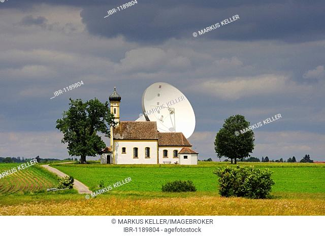 Parabolic antenna at the Erdfunkstelle, station for radio, television and data communications, with a chapel near Raisting, district of Weilheim-Schongau