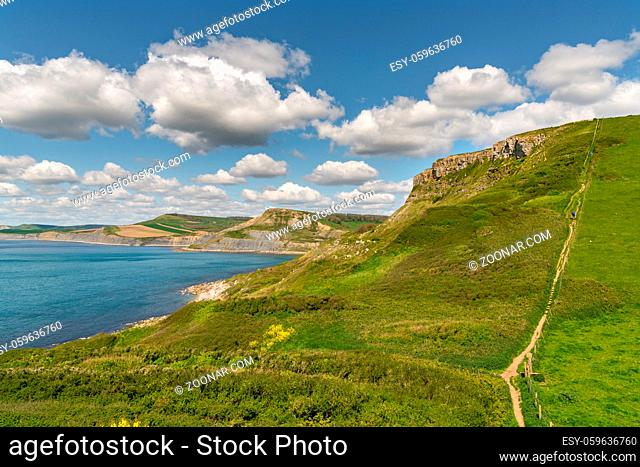 South West Coast Path with a view over the Jurassic Coast and the climb up on Emmett's Hill, near Worth Matravers, Jurassic Coast, Dorset, UK