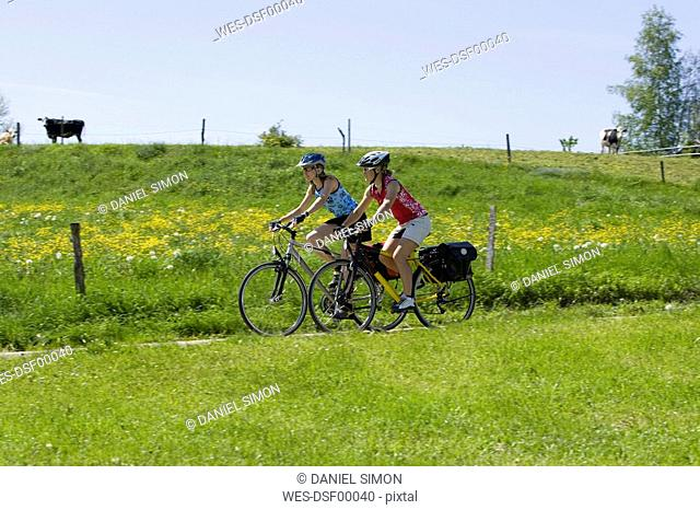 Germany, Bavaria, Oberland, Two women mountain biking