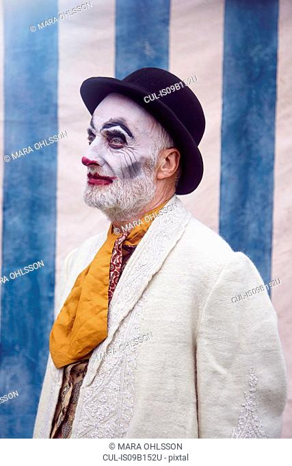 Portrait of senior male circus clown