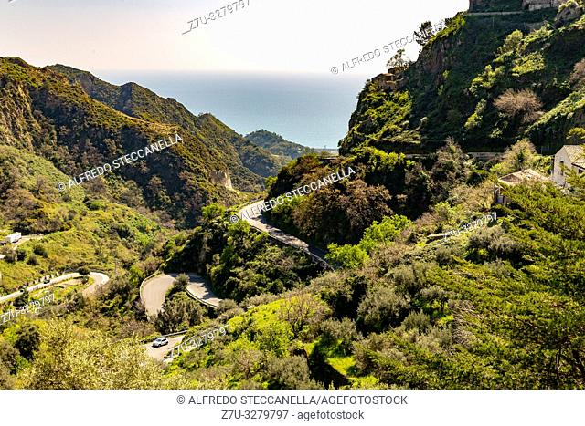 view of a green Sicilian valley with road with switchbacks