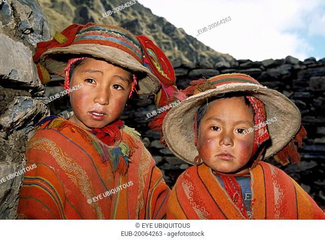 Tastayoc Village. Head and shoulders portrait of Quechua Indian boys wearing traditional clothing