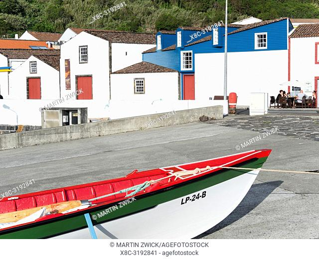 Traditional boat for whaling, background the whaling museum. Village Lajes do Pico on Pico Island, an island in the Azores (Ilhas dos Acores) in the Atlantic...