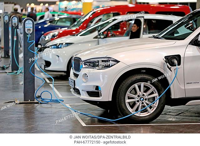 ABMW X5 xDrive40e as Plug-in-Hybrid with eDrive is charged at a charging pole in an exhibition hall during a conference for electromobility in Leipzig (Saxony)