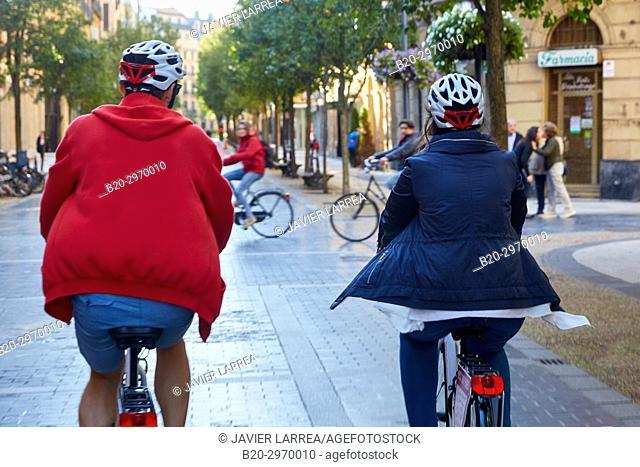 Group of tourists and guide making a bicycle tour through the city, Donostia, San Sebastian, Gipuzkoa, Basque Country, Spain, Europe