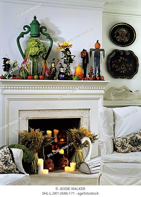 Halloween: White room and fireplace with a mantel display of halloween folk art of all kinds, witches, pumpkins, jack-o-lanterns, candles