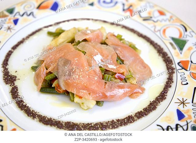 Slices of salmon on vegetable salad with truffle sauce Spain