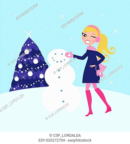 Woman building winter christmas snowman