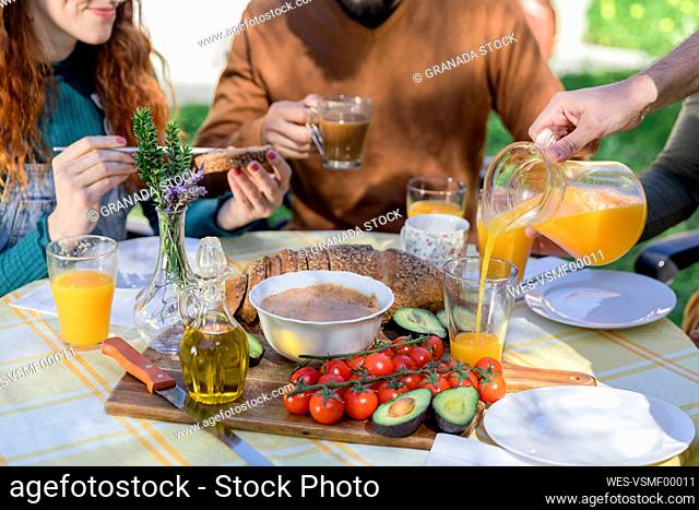 Close-up of friends enjoying a healthy vegan breakfast outdoors