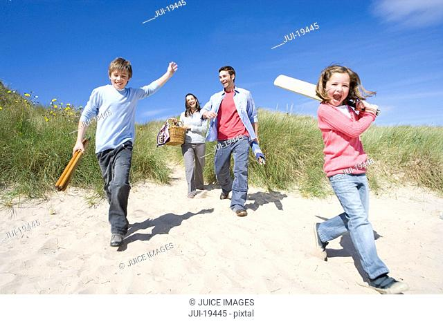 Parents with children walking on beach