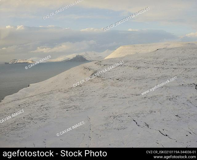 Aerial view of snowy mountains in the Faroe Islands